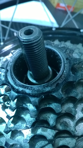 Missing nut and spacer on axle. note the fine shavings of aluminum.
